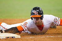 Carter Burgess #8 of the Sam Houston State Bearkats slides head first into third base with a triple against the Texas Longhorns at Minute Maid Park on March 2, 2014 in Houston, Texas.  The Longhorns defeated the Bearkats 3-2 to finish the tournament 3-0.  (Brian Westerholt/Four Seam Images)