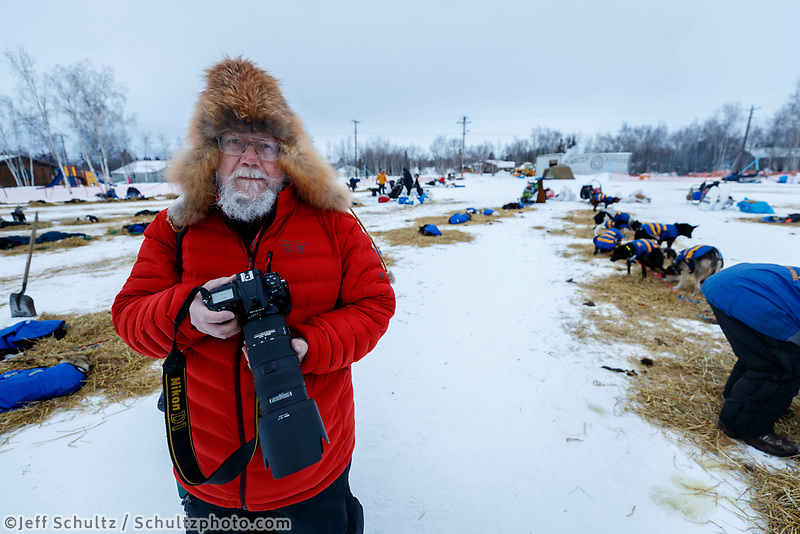 Photographer Bob Hallinen at the Huslia checkpoint during the 2017 Iditarod on Saturday morning March 11, 2017.<br /> <br /> Photo by Jeff Schultz/SchultzPhoto.com  (C) 2017  ALL RIGHTS RESERVED