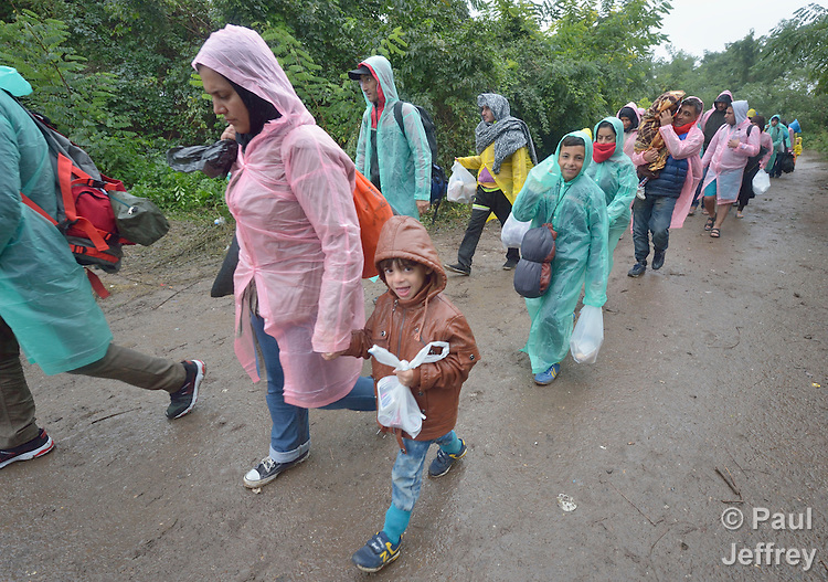 Refugees and migrants on their way to western Europe walk across the border into Croatia near the Serbian village of Berkasovo.