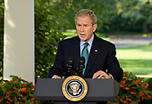 United States President George W. Bush delivers remarks on the military and political situation in Georgia outside the Oval Office at the White House in Washington, DC, Friday, August 15, 2008.<br /> Credit: Mannie Garcia / Pool via CNP