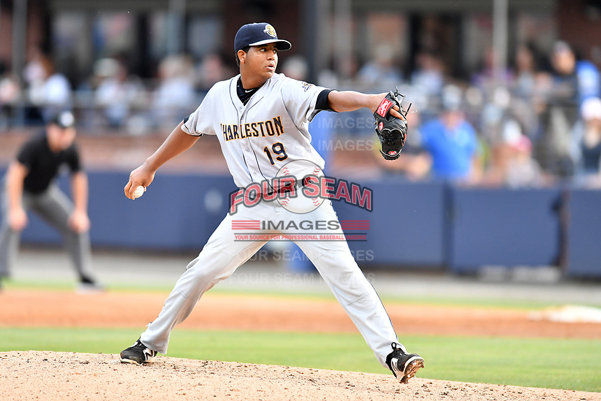 Charleston RiverDogs starting pitcher Rony Garcia (19) delivers a pitch during a game against the Asheville Tourists at McCormick Field on July 5, 2017 in Asheville, North Carolina. The RiverDogs defeated the Tourists 10-9. (Tony Farlow/Four Seam Images)