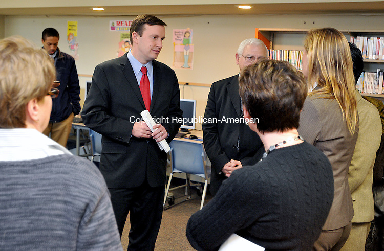 TORRINGTON,  CT, 19 JANUARY  2012-011912JS03-Rep. Christopher Murphy, D-5th District, center, talks with school officals and area politicans during a visit to East School in Torrington on Thursday. Murphy was getting a look at all of the improvements the school needs.                                                                                                                  . Jim Shannon Republican-American