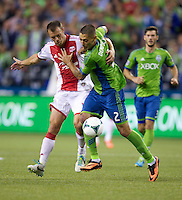 Jack Jewsbury, left, of the Portland Timbers battles Clint Dempsey of the Seattle Sounders FC during play at CenturyLink Field in Seattle Saturday August, 3, 2013. The Sounder won the match 1-0.