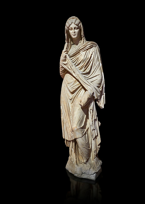 Roman statue of young Faustina. Marble. Perge. 2nd century AD. Inv no 3045 . Antalya Archaeology Museum; Turkey. Against a black background.