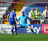 Lincoln City's Matt Gilks denies Tranmere Rovers' Connor Jennings<br /> <br /> Photographer Andrew Vaughan/CameraSport<br /> <br /> The EFL Sky Bet League Two - Lincoln City v Tranmere Rovers - Monday 22nd April 2019 - Sincil Bank - Lincoln<br /> <br /> World Copyright © 2019 CameraSport. All rights reserved. 43 Linden Ave. Countesthorpe. Leicester. England. LE8 5PG - Tel: +44 (0) 116 277 4147 - admin@camerasport.com - www.camerasport.com