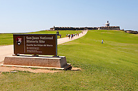 National Park Service sign in foreground welcoming visitors to El Morro, San Juan, Puerto Rico.