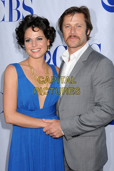 "LANA PARILLA & GRANT SHOW.""Swingtown"" Premiere Summer Block Party at CBS Radford Studios, Studio City, California, USA..May 20th, 2008.half length grey gray suit jacket blue dress plunging low cut neckline gold necklaces holding hands moustache mustache facial hair .CAP/ADM/BP.©Byron Purvis/AdMedia/Capital Pictures."