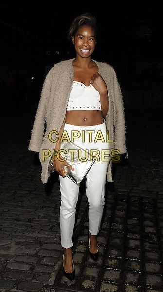 Tolula Adeyemi<br /> The Esquire magazine 2013 summer party in association with Stella Artois, Somerset House, the Strand, London, England.<br /> May 29th, 2013<br /> full length white cropped top trousers belly stomach midriff beige jacket over shoulder silver clutch bag<br /> CAP/CAN<br /> &copy;Can Nguyen/Capital Pictures
