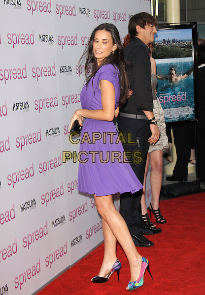 "DEMI MOORE & ASHTON KUTCHER.at The Anchor Bay Films screening of ""Spread""  held at The Arclight Theatre in Hollywood, California, USA,.August 3rd 2009.                                                                  .full length purple dress grecian black clutch bag patent multi-coloured peep toe print shoes hand ring back side over shoulder turning husband wife couple.CAP/DVS.©Debbie VanStory/Capital Pictures"