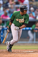 Savannah Sand Gnats first baseman Dominic Smith #22 swings at a pitch during a game against the  Asheville Tourists at McCormick Field July 17, 2014 in Asheville, North Carolina. The Tourists defeated the Sand Gnats 8-7. (Tony Farlow/Four Seam Images)