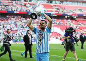 28th May 2018, Wembley Stadium, London, England;  EFL League 2 football, playoff final, Coventry City versus Exeter City; Maxime Biamou of Coventry City lifts the EFL League 2 trophy in front of the Coventry City fans