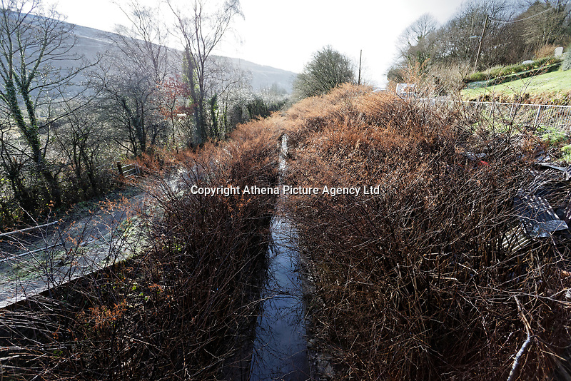 A small canal which runs past the area affected by landslip in Ystalyfera, south Wales, UK. Wednesday 23 January 2019
