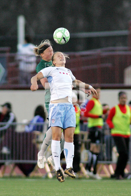 Sara Larsson , Ella Masar (white) challenge for a head ball..Saint Louis Athletica were defeated 1-0 by Chicago Red Stars .