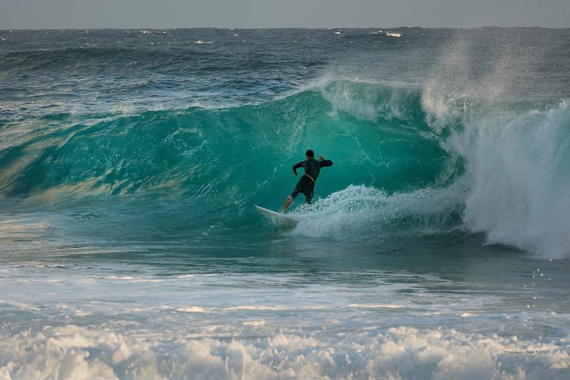Surfer at Shipwreck Beach. Kauai, Hawaii