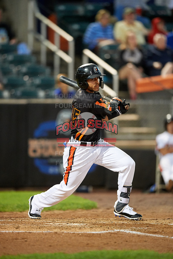 Aberdeen IronBirds second baseman Alexis Torres (35) follows through on a swing during a game against the Staten Island Yankees on August 23, 2018 at Leidos Field at Ripken Stadium in Aberdeen, Maryland.  Aberdeen defeated Staten Island 6-2.  (Mike Janes/Four Seam Images)