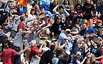 Fans reach for a home run ball during a spring training game between the Arizona Diamondbacks and the Chicago Cubs in Phoenix, AZ, on Thursday, March 23, 2017.<br /> Photo by Cathleen Allison/Nevada Photo Source