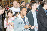 People wait to meet Democratic presidential candidate Pete Buttigieg as greets people and signs copies of his book after speaking at a campaign event at Gibson's Bookstore in Concord, New Hampshire, USA, on Sat., Apr. 6, 2019. Buttigieg is the mayor of South Bend, Indiana, and was widely considered a long-shot candidate until his appearance in a CNN town hall in March 2019 which catapulted his campaign to prominence and substantial donations.