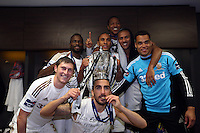 Pictured: Swansea players Jonathan de Gzman (TOP) mid row L-R Roland Lamah, Ashley Williams, Wayne Routledge, goalkeeper Michel Vorm and front row Ben Davies, Chico Flores with the cup in the changing room after the game. Sunday 24 February 2013<br /> Re: Capital One Cup football final, Swansea v Bradford at the Wembley Stadium in London.