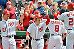 12 April 2012: Washington Nationals Bat Boy gets high fives from players after scoring against the Cincinnati Reds at Nationals Park in Washington, DC. The Nationals defeated the Reds 3-2 in 10 innings to take the first game of their 4-game series. Mandatory Credit: Ed Wolfstein Photo