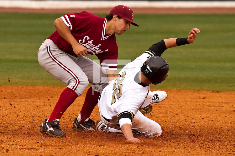 NASHVILLE, TENNESSEE-Feb. 27, 2011:  Kenny Diekroeger of Stanford tags out Jason Esposito during the game at Vanderbilt.  Stanford defeated Vanderbilt 5-2.