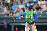 Center fielder Khalil Lee (9) of the Lexington Legends bats in a game against the Greenville Drive on Friday, June 30, 2017, at Fluor Field at the West End in Greenville, South Carolina. Lexington won, 17-7. (Tom Priddy/Four Seam Images)