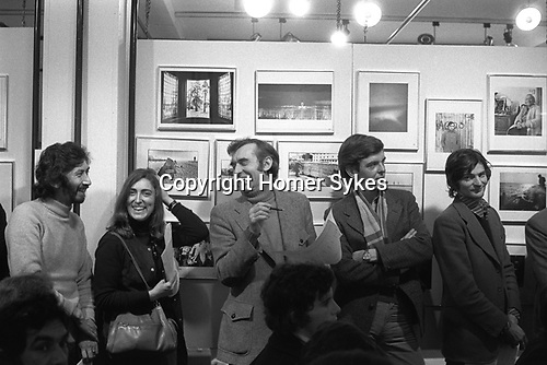 "The Photographers Gallery Great Newport Street London 1971. ""Co Optic""  Christmas Print Auction. L-R Chris Steele-Perkins, Margo Hapgood from Time Life Books. Bryn Campbell, Lewis Ambler who ran Travelling Light's mounting and framing operation, Mark Haworth-Booth."