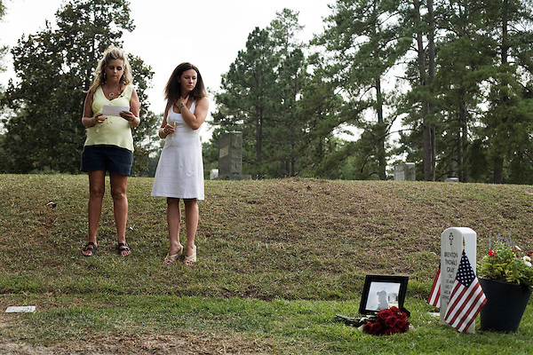 Saturday, August 8, Aberdeen, NC..A memorial service was held for Brent Gray, a former special forces soldier and private contractor killed in Iraq on August 18, 2006, at Bethesda Cemetery. After the cemetery, the memorial was continued at a favorite bar of Mr. Gray in nearby Southern Pines.. Randi Gray, left, Mr. Gray's sister and Courtney Gray, his wife, read memorial statements to the gathered friends and family.