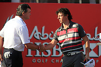 Rory McIlroy (NIR) and Paul Lawrie (SCO) finish on the 18th hole during Sunday's Final Round of the HSBC Golf Championship at the Abu Dhabi Golf Club, United Arab Emirates, 29th January 2012 (Photo Eoin Clarke/www.golffile.ie)