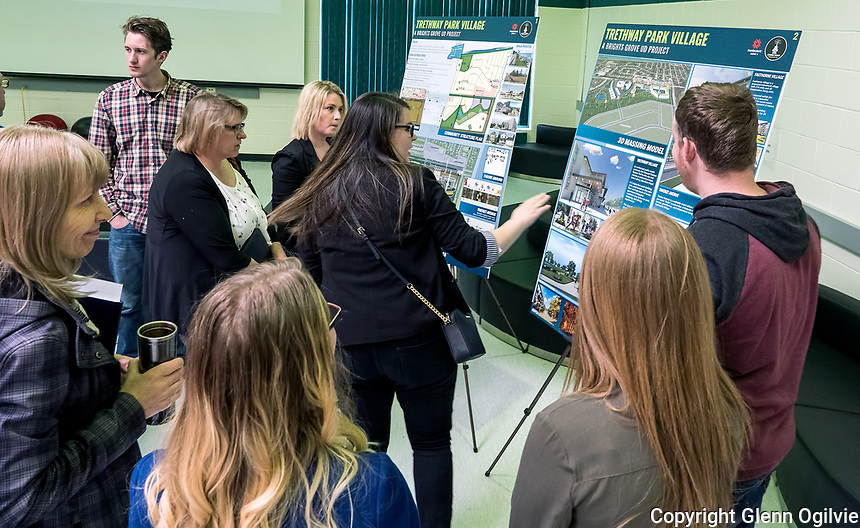 "Fanshawe College school of design and the Donald J. Smith school of building design students were asked to come up with proposals for a 26-acre piece of property near Lakeshore and Waterworks, owned by the Huzevka family. A good size crowd turned out to view four of the seven projects submitted at Brights Grove Public School. Here Jasmine Brinovcar, black sweater, explains the concept of the winning design ""Trethway Park Village to local citizens and politicians, including city clerk Dianne Gould-Brown and Sarnia councillor Cindy Schoulten. The competition was created in honour of Marshall Huzevka, a student of the school of design who died in a motorcycle accident while returning home from Fanshawe."
