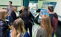 """Fanshawe College school of design and the Donald J. Smith school of building design students were asked to come up with proposals for a 26-acre piece of property near Lakeshore and Waterworks, owned by the Huzevka family. A good size crowd turned out to view four of the seven projects submitted at Brights Grove Public School. Here Jasmine Brinovcar, black sweater, explains the concept of the winning design """"Trethway Park Village to local citizens and politicians, including city clerk Dianne Gould-Brown and Sarnia councillor Cindy Schoulten. The competition was created in honour of Marshall Huzevka, a student of the school of design who died in a motorcycle accident while returning home from Fanshawe."""