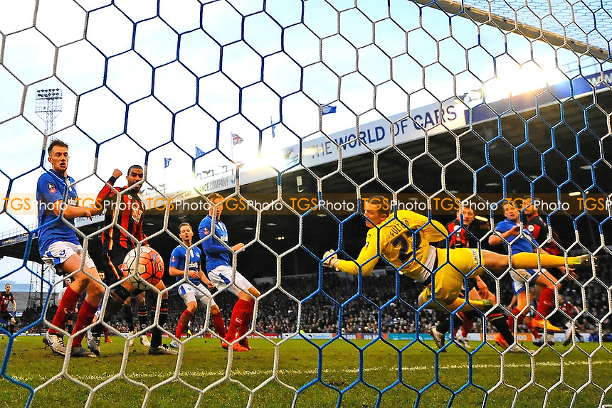 Joshua King of AFC Bournemouth right heads past Ryan Fulton of Portsmouth for the first AFC Bournemouth goal during Portsmouth vs AFC Bournemouth, Emirates FA Cup Football at Fratton Park