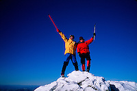 Winter climbers wave in triumph after successfully reaching the summit of Mt. Adams in the White Mountain National Park. New Hampshire.