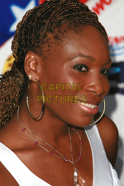 "VENUS WILLIAMS.""Talladega Nights: The Ballad of Ricky Bobby"" Los Angeles Premiere held at Mann's Grauman Chinese Theater, Hollywood, California, USA..July 26th, 2006.Photo: Charles Harris/AdMedia/Capital Pictures.Ref: CH/ADM.headshot portrait crystal necklace hoop earrings braids plaits.www.capitalpictures.com.sales@capitalpictures.com.©AdMedia/Capital Pictures."