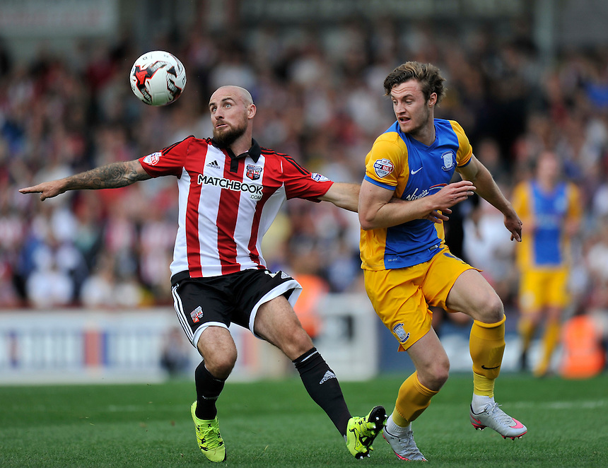 Preston North End's Will Keane battles for possession with Brentford's Alan McCormack<br /> <br /> Photographer Ashley Western/CameraSport<br /> <br /> Football - The Football League Sky Bet Championship - Brentford v Preston North End - Saturday 19th September 2015 - Griffin Park - London<br /> <br /> &copy; CameraSport - 43 Linden Ave. Countesthorpe. Leicester. England. LE8 5PG - Tel: +44 (0) 116 277 4147 - admin@camerasport.com - www.camerasport.com