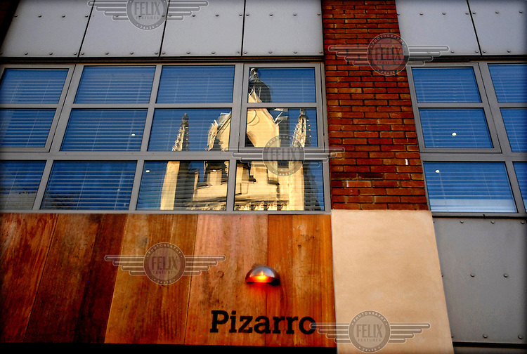 Pizarro restaurant, owned by spanish Jose Pizarro, on Bermonset Street in London; St Mary Magdalen church reflected on its first floor window.