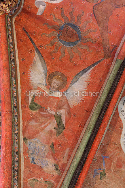 Fresco of an angel holding a liturgical book, wings outstretched, 1380, attributed to Jan de Bruges, on the vaulted ceiling of the Chapelle de la Vierge or Chapel of the Virgin, in the Cathedrale Saint-Julien du Mans or Cathedral of St Julian of Le Mans, Le Mans, Sarthe, Loire, France. The frescoes were restored in the late 20th century. The cathedral was built from the 6th to the 14th centuries, with both Romanesque and High Gothic elements. It is dedicated to St Julian of Le Mans, the city's first bishop, who established Christianity in the area in the 4th century AD. Picture by Manuel Cohen