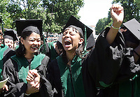 Eindra khin Khin, left, watches her friend Deidra Hilliard, right, cry out as the School of Medicine is confirmed during the 2006 Graduation ceremonies held Sunday May 21, 2006 at the University of Virginia in Charlottesville, Va. Photo/Andrew Shurtleff