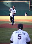 Tim Milligan throws out a ceremonial first pitch at the Reno Aces game in Reno, Nev., on Saturday, April 18, 2015.<br /> Photo by Cathleen Allison