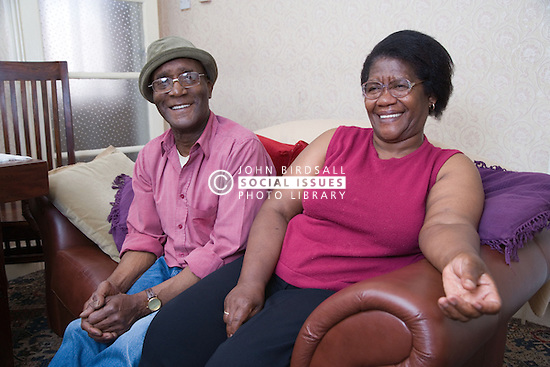 Elderly couple relaxing at home together,