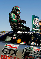 Sept. 6, 2010; Clermont, IN, USA; NHRA funny car driver John Force climbs from his car after losing in the finals of the U.S. Nationals at O'Reilly Raceway Park at Indianapolis. Mandatory Credit: Mark J. Rebilas-