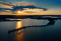 Aerial image Horseshoe Bay Lighthouse peninsula during sunset. Summer is a popular time for tourism in Horseshoe Bay as vacationers come to visit Horseshoe Bay for recreational swimming, fishing, boating along with other water activities.