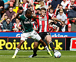Kamohelo Mokotjo of Brentford and Jack O'Connell of Sheffield Utd during the English Championship League match at Bramall Lane Stadium, Sheffield. Picture date: August 5th 2017. Pic credit should read: Simon Bellis/Sportimage