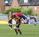 Livy's Jason Talbot goes over Alloa's Declan McManus.