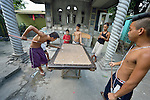 "In the capital of the Philippines, youth play a game in the Manila North Cemetery. Hundreds of poor families live here, dwelling in and between the tombs and mausoleums of the city's wealthy. They are often discriminated against, and many of their children don't go to school because they're too hungry to study and they're often called ""vampires"" by their classmates. With support from United Methodist Women, KKFI provides classroom education and meals to kids from the cemetery at a nearby United Methodist Church."