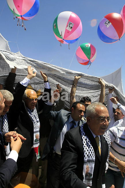 Palestinian Prime Minister, Salam Fayyad attends the launching ceremony of the largest Palestinian traditional scarf ''kefiya'' in the West Bank city of Ramallah, on May 13, 2010. The ceremony was held on Thursday in preparations for marking the 62nd anniversary of Nakba Day, which comes Saturday. On May 15 every year, Palestinians mark the creation of Israel and the subsequent dispersal of hundreds of thousands of Palestinians as the Nakba, or ''catastrophe'' in Arabic. photo by Issam Rimawi