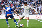 Gaizka Toquero of Club Deportivo Alaves competes for the ball with Cristiano Ronaldo of Real Madrid during the match of  La Liga between Real Madrid and Deportivo Alaves at Bernabeu Stadium Stadium  in Madrid, Spain. April 02, 2017. (ALTERPHOTOS / Rodrigo Jimenez)
