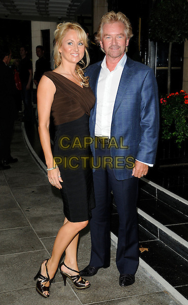 LIZ DAVIES & NOEL EDMONDS.TV Choice & TV Quick Awards at the Dorchester Hotel, Park Lane, London, England. .September 7th 2009.full length black dress blue suit jacket white shirt goatee facial hair married husband wife brown trousers .CAP/CAN.©Can Nguyen/Capital Pictures.