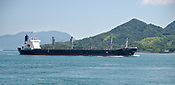 A freighter passing Okunoshima in Hiroshima Prefecture Japan.