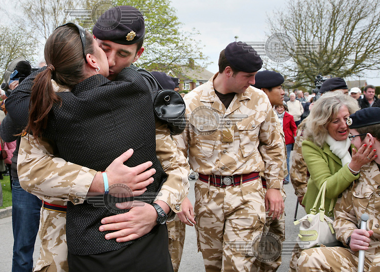 Soldiers from the British army's 11th EOD regiment (Counter IED Task Force) are greeted by their families and members of the public in Didcot, Oxfordshire, on their return from Afghanistan. Sapper Ryan Seary, 21, who lost an arm and a leg when a booby-trap bomb exploded, is seen on the far right.