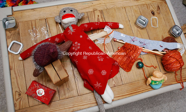 FAIRFIELD, CT, 01/12/08- 011209BZ04- A sock monkey in a nightshirt made by Liz Seaman for her daughter Tierney Latham, 4, rests on a table in their Fairfield home Monday. <br />  Jamison C. Bazinet Republican-American